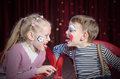 Boy And Girl Clowns Sticking Out Tongues Stock Image - 54239641