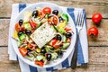 Greek Salad Of Organic Tomatoes, Cucumber, Red Onion, Olives And Feta Cheese Stock Images - 54253414