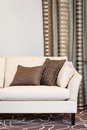 Brown Pillows On Empty Beige Sofa Stock Photography - 54275052