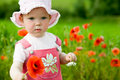 Baby-girl With Red Flower Royalty Free Stock Photography - 5434667