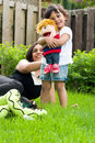 Mother And Daughter Playing Outside Stock Image - 5439131