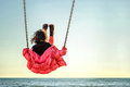 Little Girl On The Swing Royalty Free Stock Image - 54348556