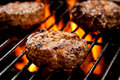 Burgers On The Grill Royalty Free Stock Photo - 54352495