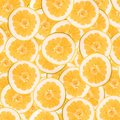 Abstract Background With Slices Of Fresh Grapefruit. Seamless Pattern For Design. Close-up. Studio Photography. Stock Image - 54359561