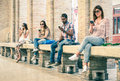 Group Of Young Multiracial Friends Using Smartphone Stock Photography - 54362862