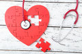 Red Puzzle Heart Stock Photography - 54363192