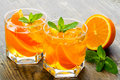 Cocktail. Orange Juice With  Mint And Ice Rustic Stock Photography - 54379742
