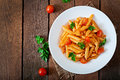 Penne Pasta In Tomato Sauce With Chicken, Tomatoes Decorated With Parsley Royalty Free Stock Photo - 54383855