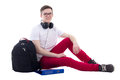 Handsome Teenage Boy With Backpack And Headphones Sitting Isolat Stock Photo - 54395770