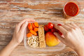 Close Up Of Hands With Vegetarian Food In Box Stock Photos - 54399913