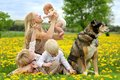 Mother And Three Children Playing In Flower Meadow Stock Photo - 54439020