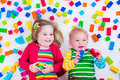 Kids Playing With Colorful Blocks Stock Image - 54449941