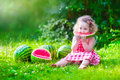 Little Girl Eating Watermelon Stock Images - 54450284