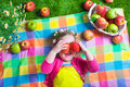 Cute Little Girl Eating Apples Royalty Free Stock Photography - 54450427