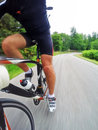 Road Bike; Male Cyclist Riding A Racing Bike Downhill Royalty Free Stock Images - 54485419
