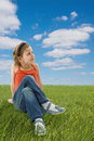 Cute Girl Sitting On The Green Grass Stock Photo - 5451630