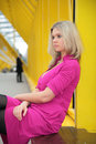 Young Blonde Sits On Footbridge Royalty Free Stock Photo - 5452625