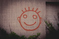 Graffiti Painting Of Red Happy Smiley Face On A Concrete Wall Stock Photo - 54512460