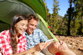 Camping Couple In Tent Using Smartphone Royalty Free Stock Image - 54514276