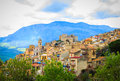 View Of Caccamo Town On The Hill With Mountains Background On Cloudy Day In Sicily. Stock Photos - 54563853