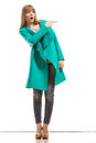 Woman In Green Coat Showing Copy Space Royalty Free Stock Images - 54564449