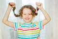 Laughing Girl Pull Her Pigtails Up By Hand And Show Her Teethes. Royalty Free Stock Photography - 54566877