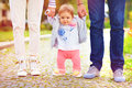 Cute Little Baby Girl On Walk With Parents, First Steps Stock Photography - 54568522