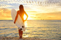 Surfing Surfer Girl Looking At Ocean Beach Sunset Stock Images - 54572044