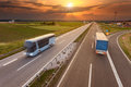 Truck And Bus In Motion Blur On The Highway At Sunset Royalty Free Stock Photos - 54577798