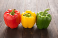 Set Of Colored Bell Peppers On Wooden Background Royalty Free Stock Photography - 54579657