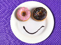 Smiley Happy Face Made On Dish With Donuts Eyes And Chocolate Syrup As Smile In Sugar And Sweet Addiction Nutrition Stock Image - 54589171