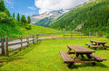 Wooden Benches To Picnic In Alpine Valley, Austria Stock Photography - 54616732