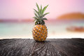 Pineapple On Wooden Desk And Beach Side Background With Clipping Path Royalty Free Stock Image - 54617546