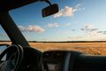 View From Car Window On The Field At Sunset Royalty Free Stock Images - 54628989