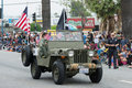 Military Vehicle With Flags During Memorial Day Parade Royalty Free Stock Photo - 54640675
