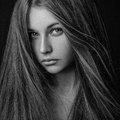 Dramatic Portrait Of A Girl Theme: Portrait Of A Beautiful Lonely Girl With Flying Hair In The Wind Isolated On Dark Background In Royalty Free Stock Photo - 54649525