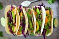 Fish Tacos With Red Cabbage Lime Slaw On Rustic Tray Royalty Free Stock Photos - 54652978