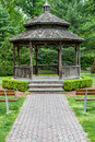 Front Of Gazebo With Wooden Benches And Paver Path. Stock Photo - 54656900