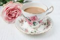 Milk Tea In A China Cup And Saucer, With Pink Roses. Stock Photo - 54670350
