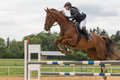 Closeup View Of High Jump Over The Horse Hurdle Royalty Free Stock Photos - 54673638