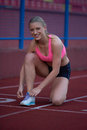 Sporty Woman On Athletic Race Track Royalty Free Stock Photo - 54709255