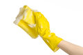 Cleaning The House And Sanitation Topic: Hand Holding A Yellow Sponge Wet With Foam Isolated On A White Background In Studio Royalty Free Stock Photography - 54713657