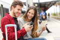 Tourists Travelers Consulting Gps And Guide In A Train Station Royalty Free Stock Photography - 54719167