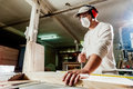Carpenter In Factory Stock Image - 54719541