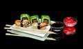 Sushi And Rolls On A Plate On A Black Background Stock Images - 54720444
