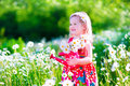 Little Girl In Daisy Flower Field Stock Photography - 54731302
