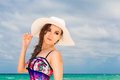 Young Beautiful Girl In A Straw White Hat On The Beach Of A Trop Royalty Free Stock Photos - 54735828