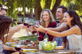 Happy Friends In The Park Having Lunch Royalty Free Stock Image - 54766996