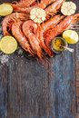 Raw Shrimp, Garlic, Lime, Curry And Sea Salt On A Dark Wooden Background Stock Images - 54768374