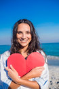 Smiling Woman Holding Heart Card At The Beach Stock Images - 54771704